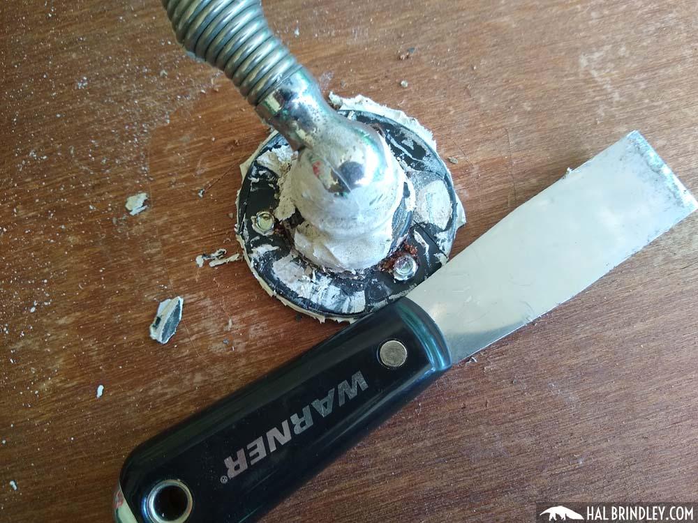removing lap sealant from radio antenna