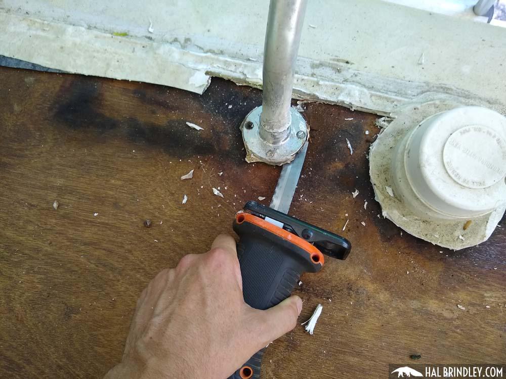 sawing through screws in ladder flange
