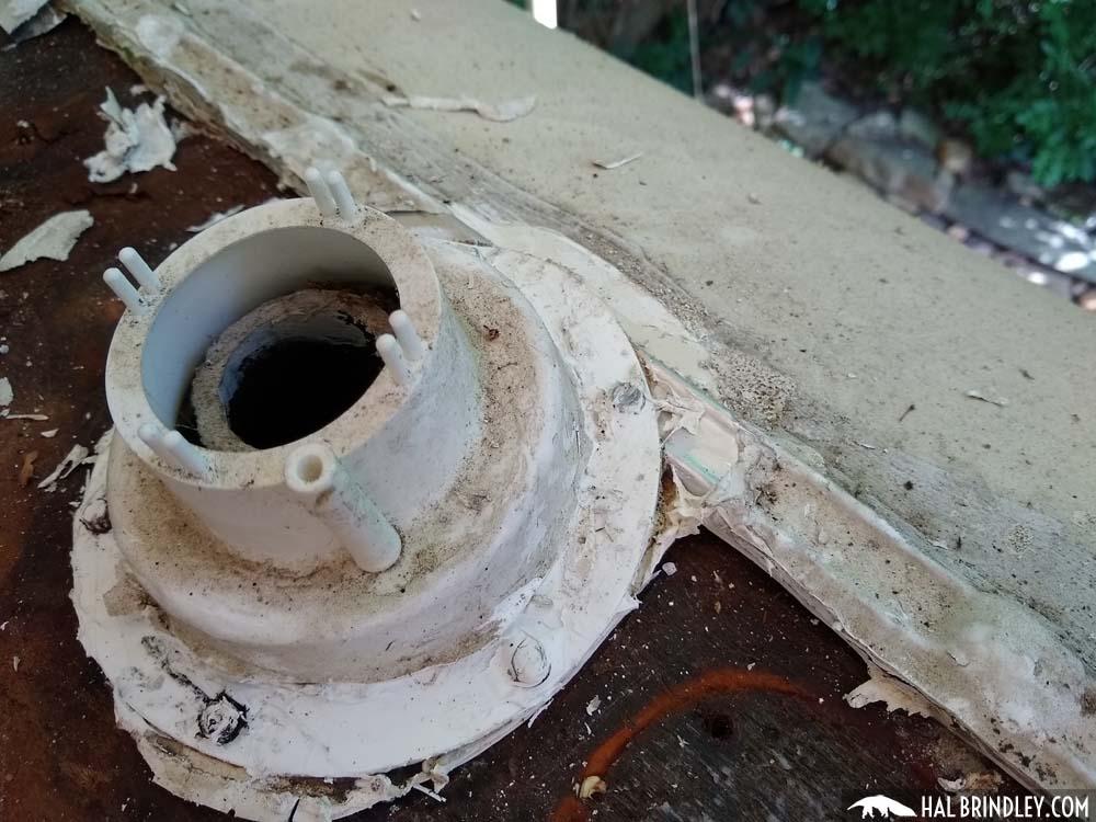 removing a plumbing vent cap during camper trailer roof repair