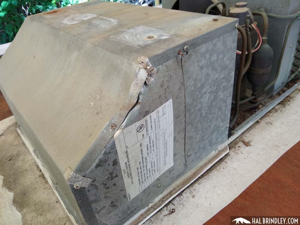 damaged RV air conditioner unit