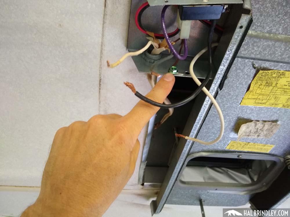 remove green grounding screw